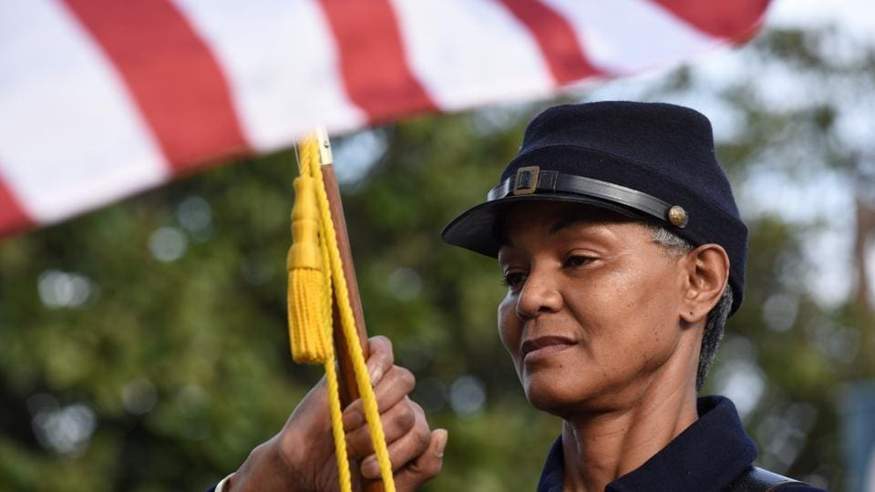 Joyce Allgood, a member of the 44th USCT reactors, carries the American flag in the annual parade to honour Martin Luther King, in Chattanooga, Tennessee. (Billy Weeks/REUTERS)