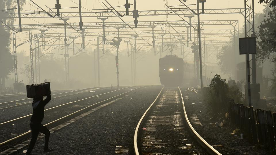 Trains were running late due to fog, at Tilak Bridge railway station in New Delhi.