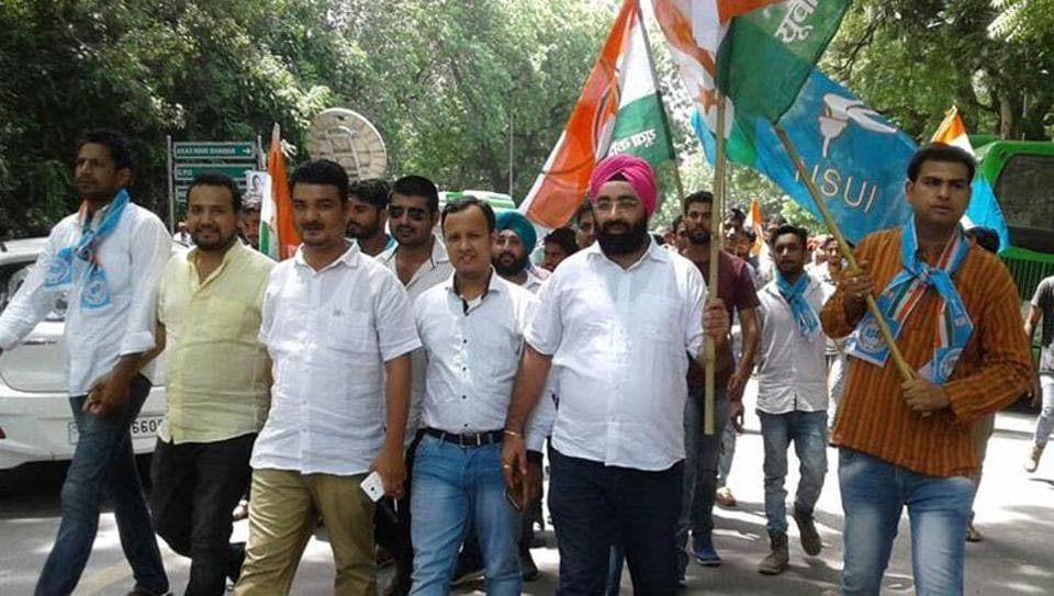 Congress youth wing members stage a protest.