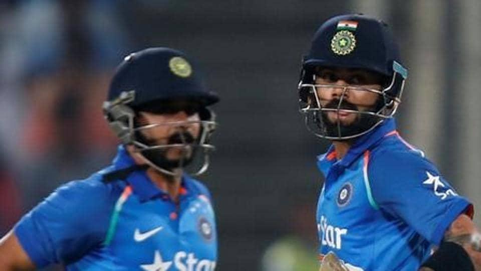 Kedar Jadhav (left) says batting with Virat Kohli (right) helped as England bowlers were more focused on restricting the India skipper