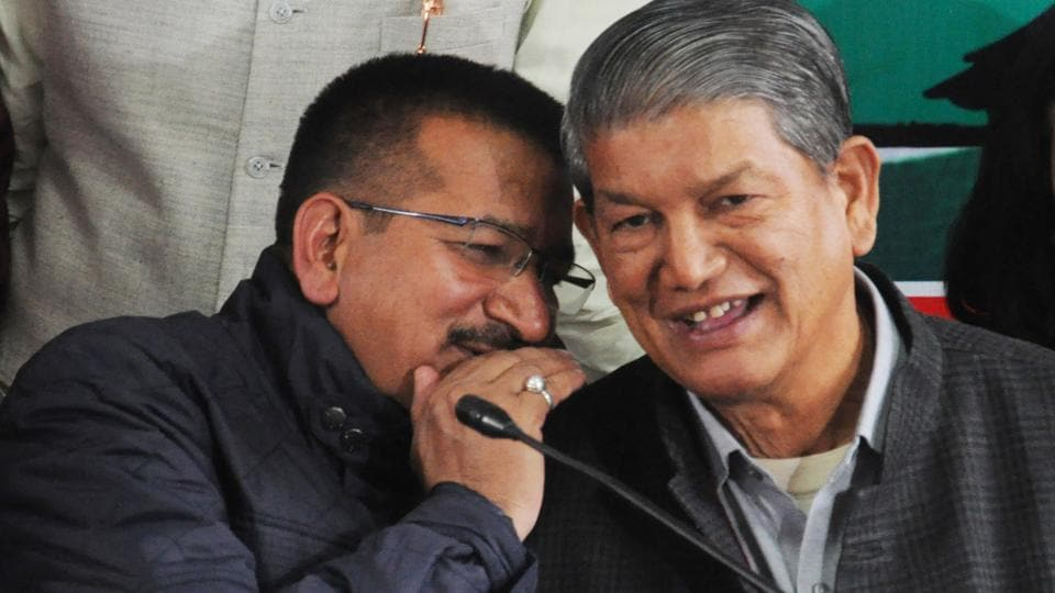 CM Harish Rawat shares a lighter moment with state Congress president Kishore Upadhyay during a press conference at Rajiv Bhawan in Dehradun on Tuesday.