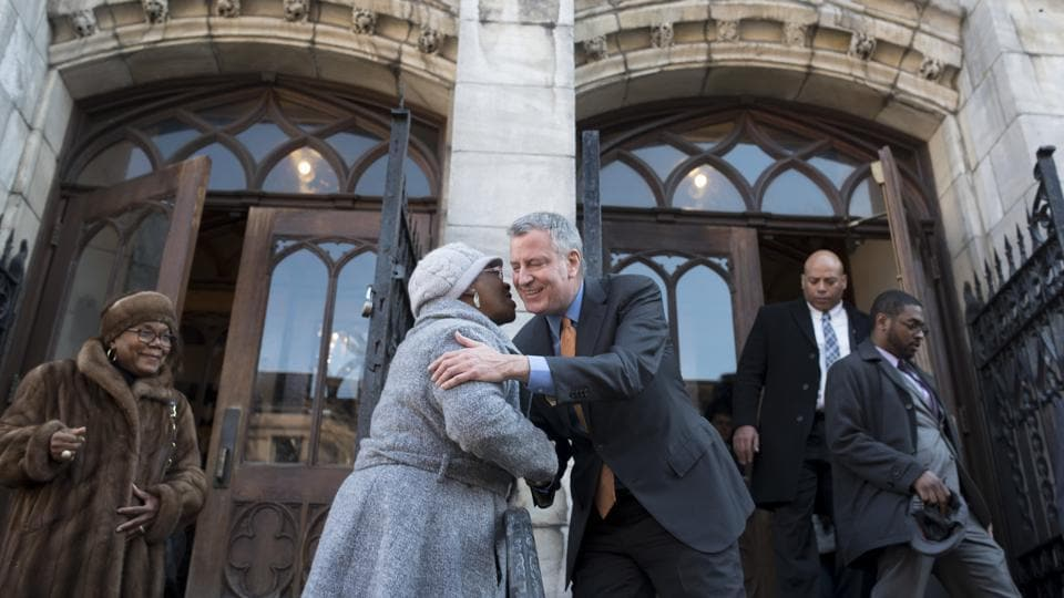 New York Mayor Bill de Blasio greets Rivania Scott as he departs the Convent Avenue Baptist Church after delivering remarks for Martin Luther King Jr. Day in New York. (Karsten Moran/NYT)