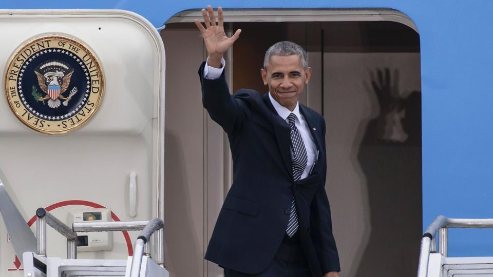 US President Barack Obama waving as he enters his plane 'Air Force One' prior to his departure from the Tegel airport in Berlin.
