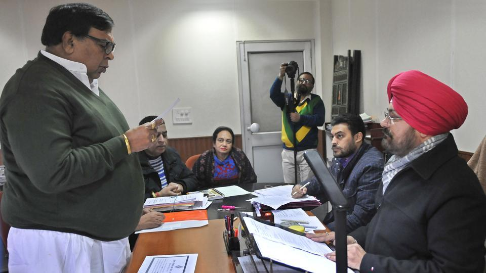 Congress candidate Surinder Dawar taking oath while filing his nomination for the upcoming assembly elections.