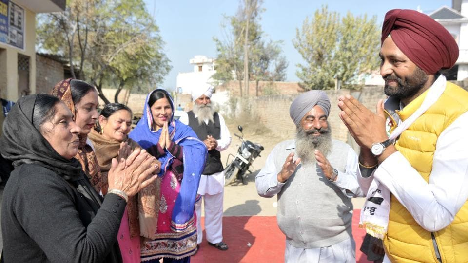 Aam Aadmi Party candidate from Shahkot Amarjit Singh Thind interacting with voters during campaigning.