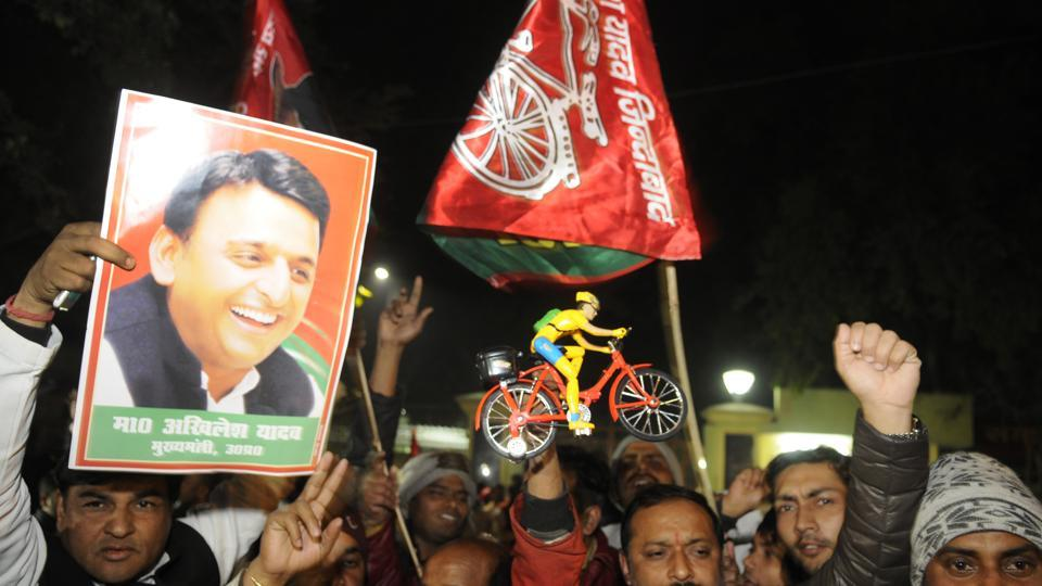 Akhilesh Yadav's supporters celebrate outside the Samajwadi Party's office in Lucknow after the Election Commission awarded him the party symbol.