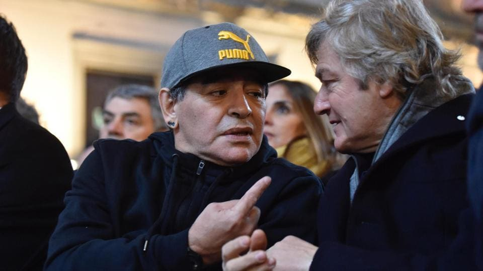 Argentinian soccer legend Diego Maradona, left, talks to Fiorentina's soccer team former striker Giancarlo Antognoni during the Italian football hall of Fame Award ceremony in Florence, Italy, Tuesday.