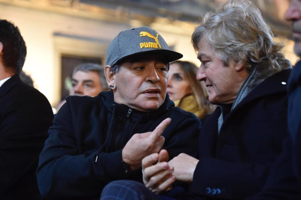 Maradona (left) talks to Fiorentina's former striker Giancarlo Antognoni during the ceremony. (AP)