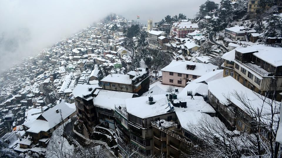 A view of snow covered roofs in city after Shimla receiving second spell of snow on Monday.