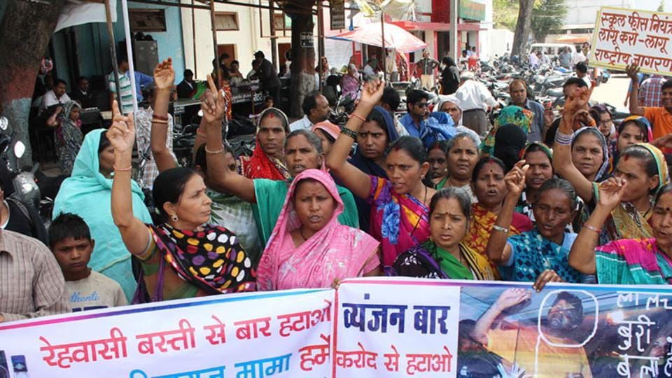Bhopal residents take out a rally demanding removal of a newly opened liquor shop in their area.