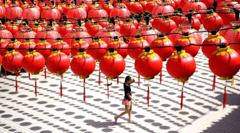 A woman walks under traditional Chinese lanterns decorated at the Thean Hou temple in Kuala Lumpur on Tuesday. (MANAN VATSYAYANA / AFP)