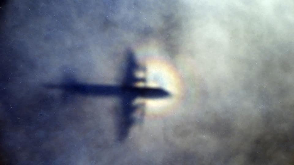 The shadow of a Royal New Zealand Air Force P3 Orion is seen on low level cloud while the aircraft searches for missing Malaysia Airlines Flight MH370 in the southern Indian Ocean, near the coast of Western Australia.