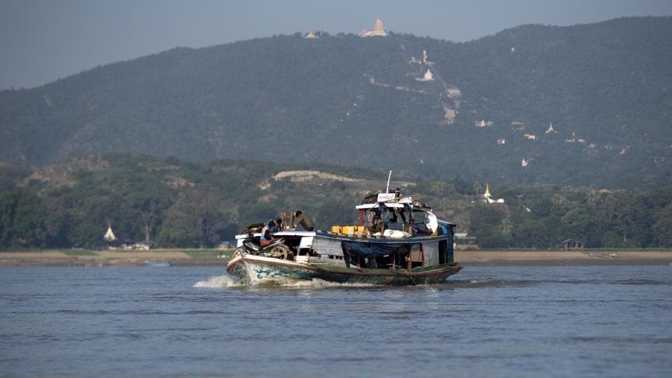 This photo taken on November 23, 2016 shows People travelling in the Irrawaddy river near Mandalay. Irrawaddy dolphins can be found in rivers, lakes and seas across southern Asia, from the northwest Bay of Bengal, in India, to the south of Indonesia. Fishermen say the greatest danger comes from rogue gangs who are wiping out river life in their quest for easy money. (Ye Aung Thu/AFP)
