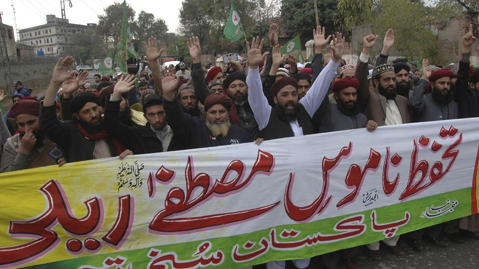 Activists from the Pakistani religious group, Sunni Tehreek, rally in support of blasphemy laws, in Rawalpindi, Pakistan.