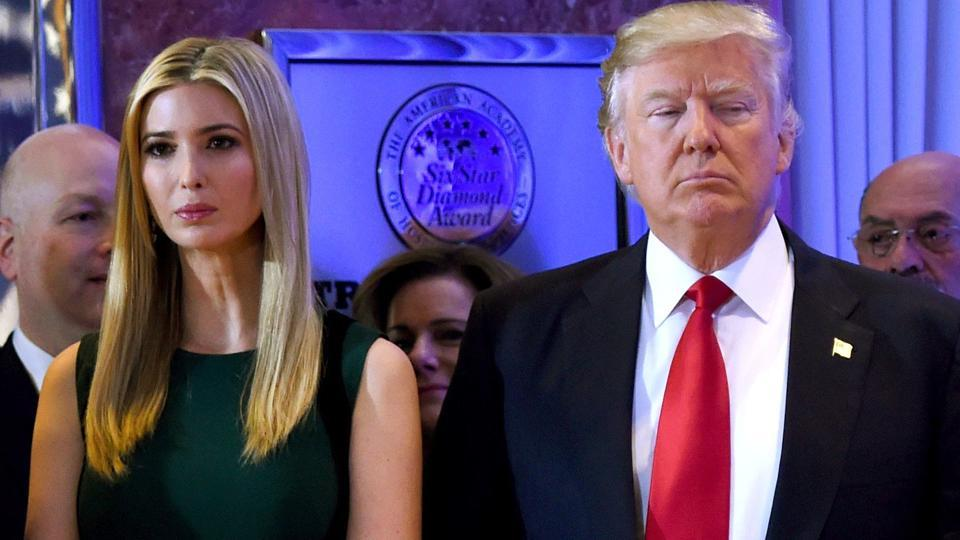 US president- elect Donald Trump stands with his daughter Ivanka at the Trump Tower in New York.