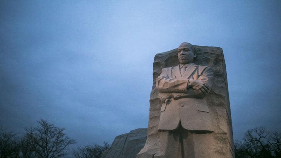 The Martin Luther King Jr. Memorial as the sun rises on a cloudy morning in Washington. (Al Drago/NYT)