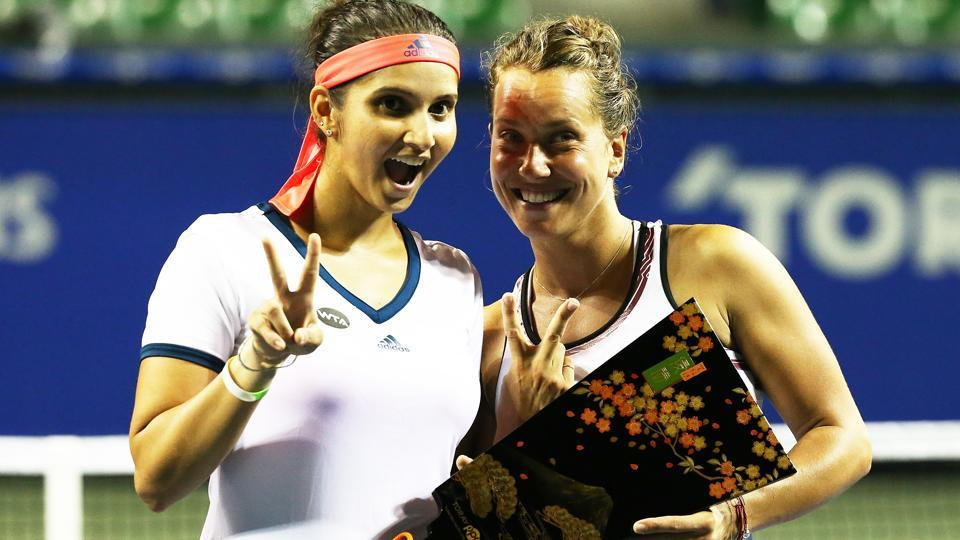 Sania Mirza of India (left) and Barbora Strycova of Czech Republic celebrate after winning the women's doubles final at the Toray Pan Pacific Open on September 24, 2016 in Tokyo.