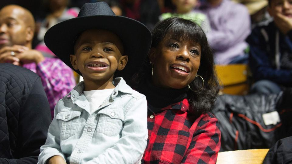 Daylen Lowe (L) and Leora Spillman (R) watch the calf roping competition during the MLK Jr. African American Heritage Rodeo at the National Western Stock Show in Denver, Colorado. (Jason Connolly/AFP)