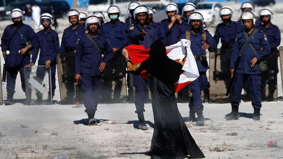 Bahraini authorities ordered an independent newspaper to stop publishing online Monday and said a city hall was set ablaze during clashes between opposition protesters and police.