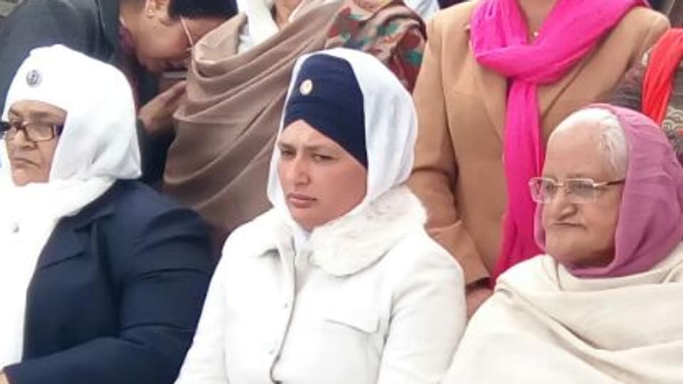 Rajdeep Kaur, sister of Rocky (centre with blue turban) at a rally in Fazilka on Tuesday.