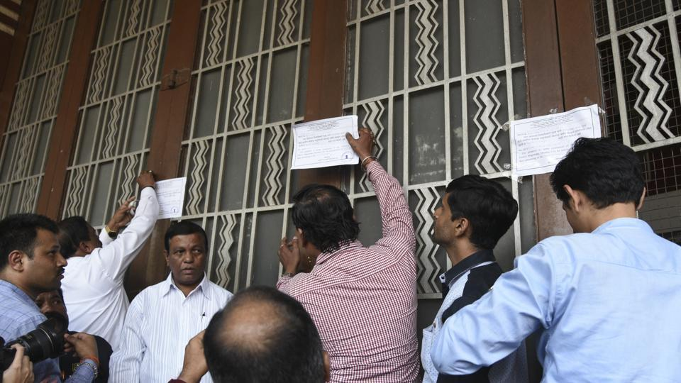 There was some resistance by the occupants, but officials from the collector's office finally took possession and sealed the property. (kunal patil/ht photo)