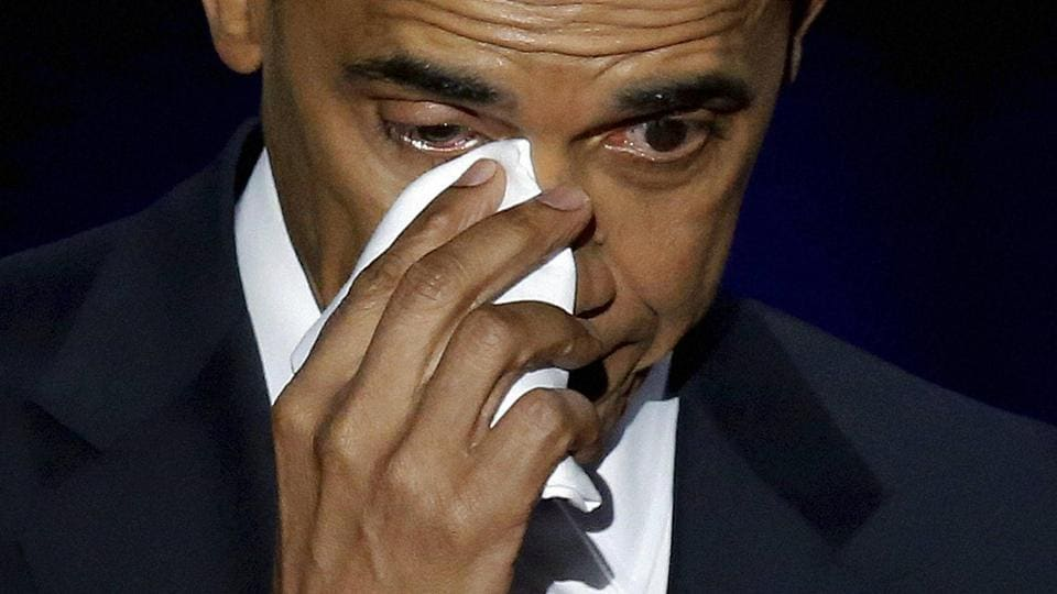 US President Barack Obama wipes his tears as he speaks at McCormick Place in Chicago  on January 10, 2017. Obama has wept at least 10 times on camera since he took office.