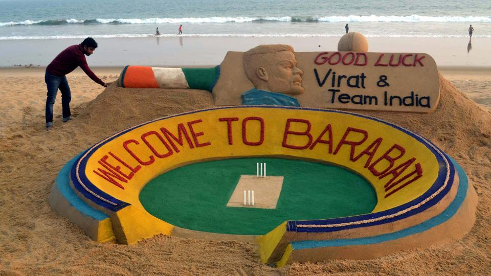Sudarsan Pattnaik creates a sand sculpture at Puri beach of Odisha on Tuesday to welcome Indian cricket team to Odisha for 2nd series match against England. (PTI)