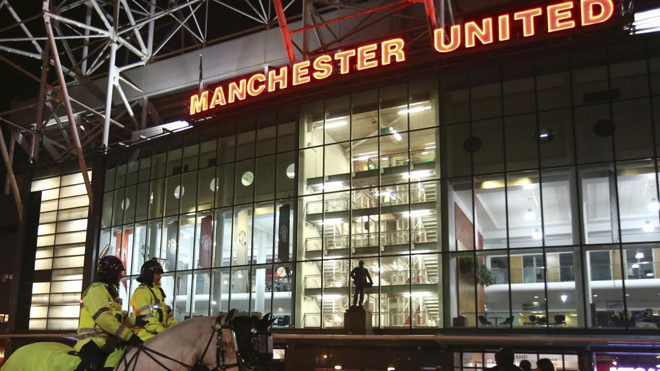 Manchester United have increased security on match days. Here, two mounted policemen patrol the Old Trafford stadium ahead of the English League Cup quarter-final against West Ham United in November.