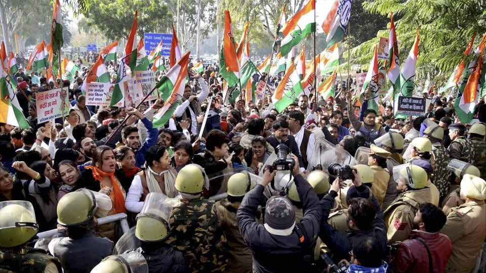 Congress party supporters protest during their RBI Gherao over demonetization in Chandigarh on Wednesday.