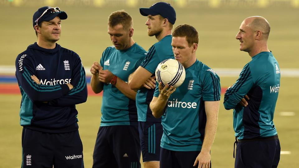 England cricket captain Eoin Morgan (2L) holds a football during a training session at the Barabati stadium in Cuttack. (AFP)