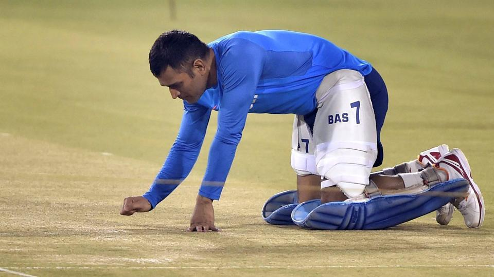 Mahendra Singh Dhoni inspects the pitch at Barabati Stadium in Cuttack on Wednesday. (PTI)