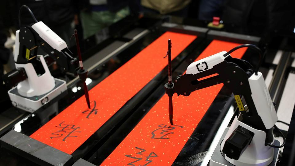 Robots write Spring Festival calligraphy couplets for employees ahead of the upcoming Spring Festival, at Alibaba's headquarters in Hangzhou, Zhejiang province, China.