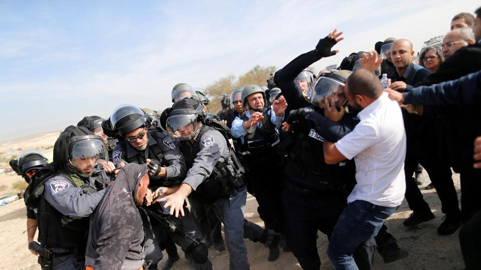 Arab Israelis clash with Israeli riot policemen in Umm Al-Hiran, a Bedouin village in Israel's southern Negev Desert, January 18, 2017.
