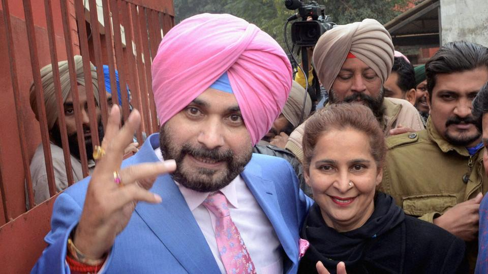 Congress party candidate and former BJP MP Navjot Singh Sidhu, accompanied by his wife Navjot Kaur Sidhu, after filing his nomination papers for upcoming Assembly elections, in Amritsar on Wednesday.