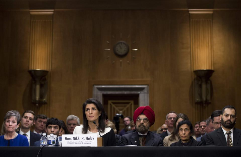 South Carolina Governor Nikki Haley surrounded by family members as she testifies during her confirmation hearing for US ambassador to the United Nations (UN) on Capitol Hill in Washington.