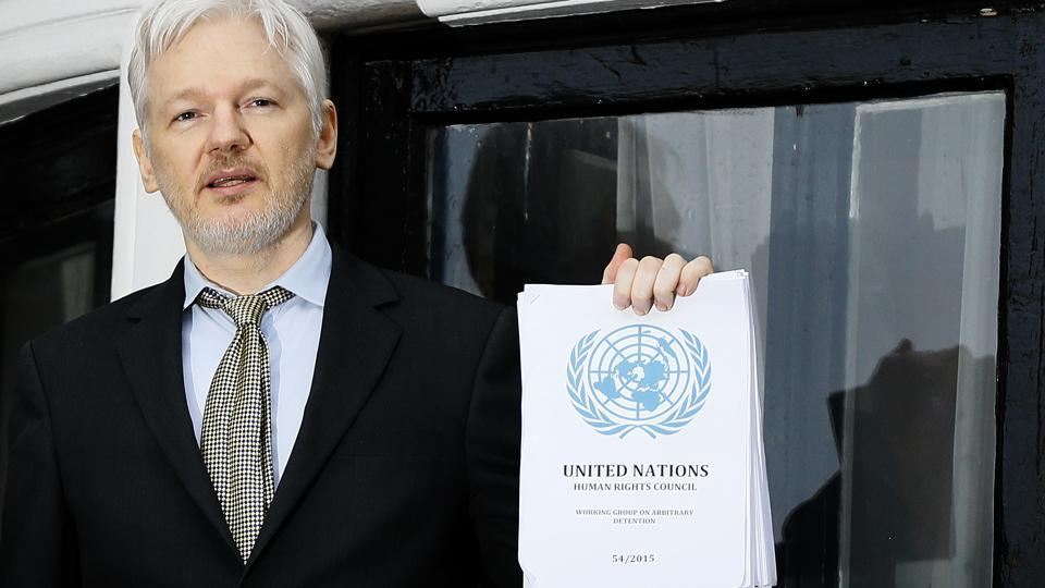 """In this  file photo WikiLeaks founder Julian Assange speaks on the balcony of the Ecuadorean Embassy in London.  In a tweet in early January 2017, Assange's anti-secrecy site WikiLeaks wrote, """"If Obama grants Manning clemency Assange will agree to US extradition despite clear unconstitutionality of DoJ case."""""""