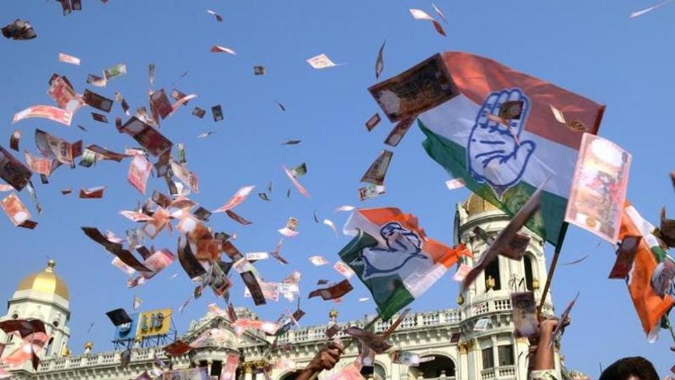 Congress workers are blowing fake Indian currency in Kolkata to protest in support of the Narada sting operation, which showed TMC leaders taking bribes.