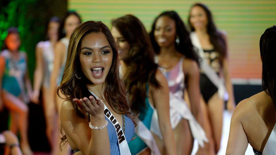 Miss Guam Muneka Joy Cruz Taisipic blows a kiss during a Miss Universe swimwear fashion show in Cebu City. (AFP)
