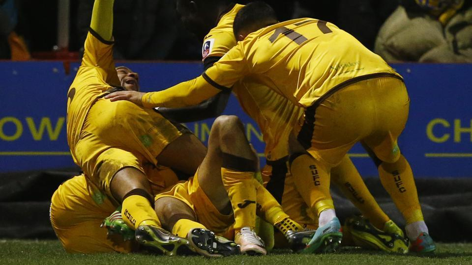 Sutton United players celebrate after scoring against AFC Wimbledon in their FACup  match on Tuesday. Sutton won 3-1 on a night which produced another surprise -- Lincoln City beating Ipswich Town. Sam Allardyce's Crystal Palace beat Bolton Wanderers to enter the fourth round.