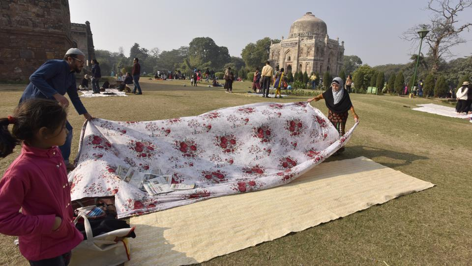 Delhiites enjoying a sunny day at Lodi Garden, in New Delhi, on December 18, 2016.