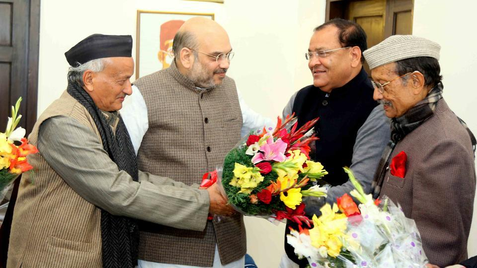 Yashpal Arya (second from right) joined the BJP in the presence of former chief minister BS Koshyari and party chief Amit Shah in New Delhi.