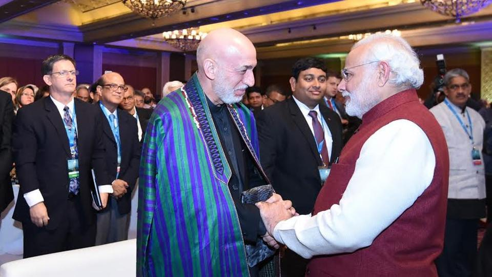 PM Narendra Modi with former Afghan President Hamid Karzai during the Raisina Dialogue in New Delhi.