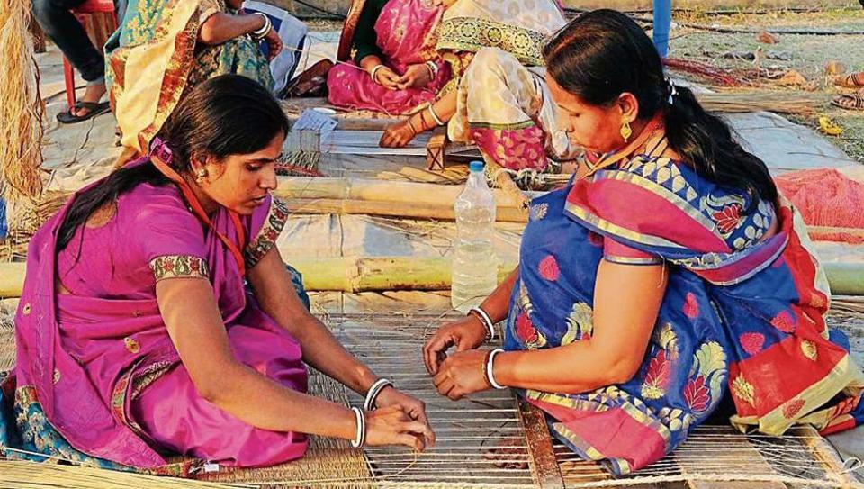 Women weave mats at Madur Mela in Digha on January 13. The festival is dedicated to traditional mat weavers.