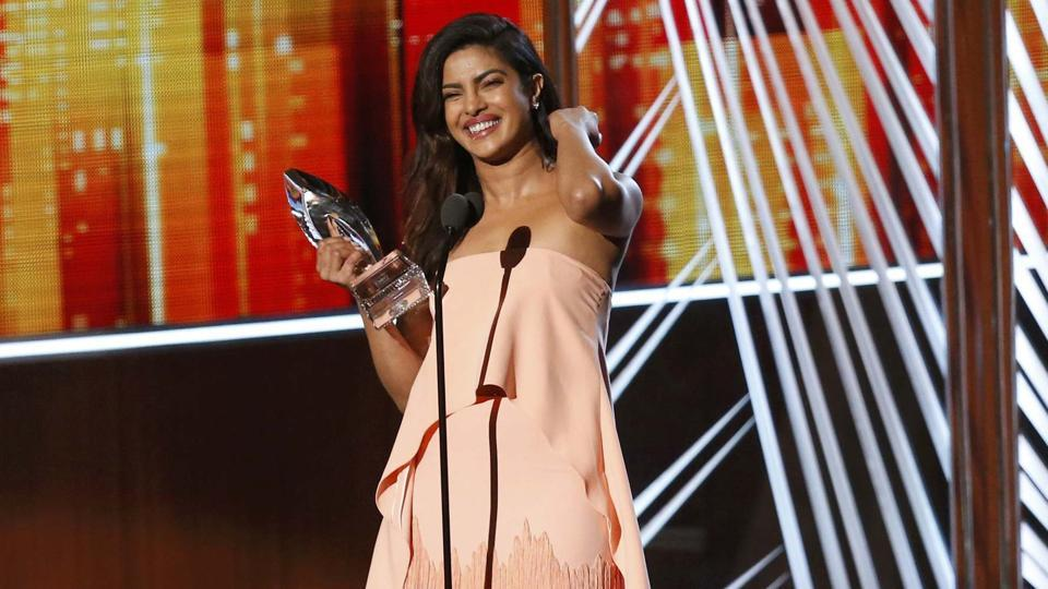 Priyanka Chopra, star of the TV show Quantico accepts the award for favourite TV Drama Actress at the People's Choice Awards 2017. (Reuters)