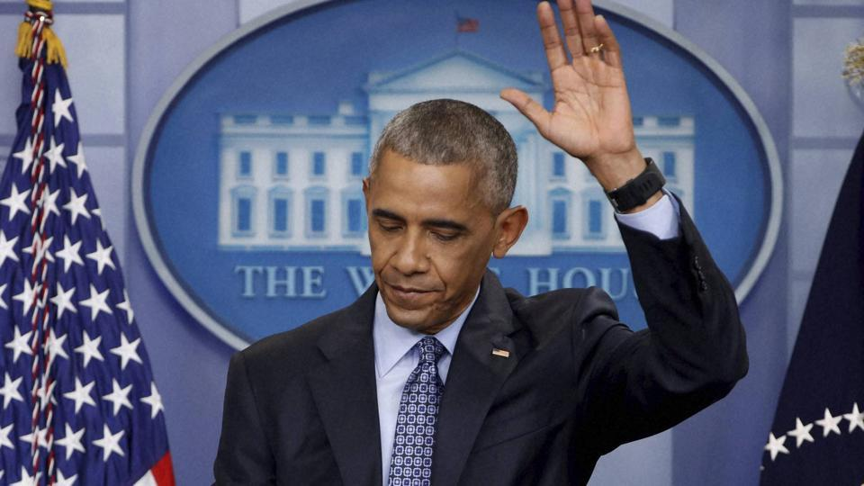 President Barack Obama waves as he concludes his final presidential news conference on Wednesday, in the briefing room of the White House in Washington.