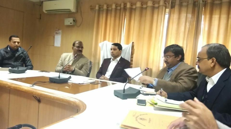 Election expenditure officer Umesh Chandrakant chairs a meeting with the DM and other election personnel.