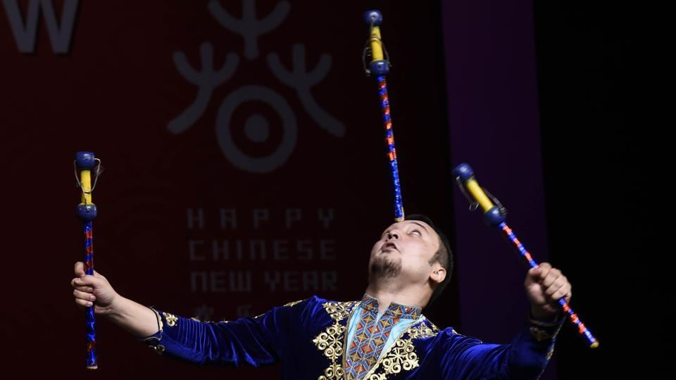 A member of Xinjiang Art Theatre song and Dance troupe performs Acrobatics hand Technique.  Their efforts in pursuing artistic excellence have been rewarded with so many awards in major domestic and international events including National Five A Award, the Lotus Award of National Dance Competition, and others.  (Arvind Yadav/HT PHOTO)