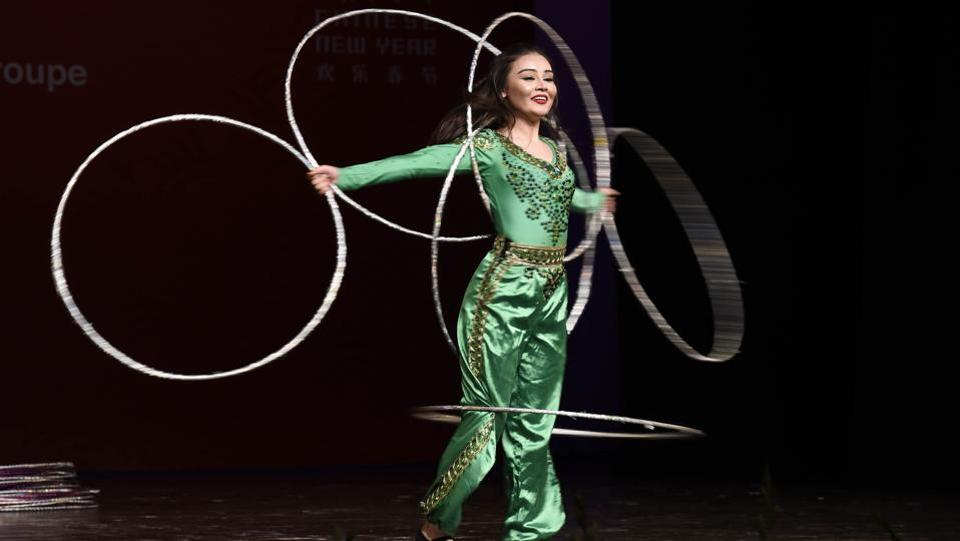 A member of Xinjiang Art Theatre song and Dance troupe performs Acrobatics Shaking Hula Hoops. Whereas, India China Economic and Cultural Council (ICEC), established in 2003 is an autonomous organization which works towards enhancing bilateral relations between India and China.  (Arvind Yadav/HT PHOTO)