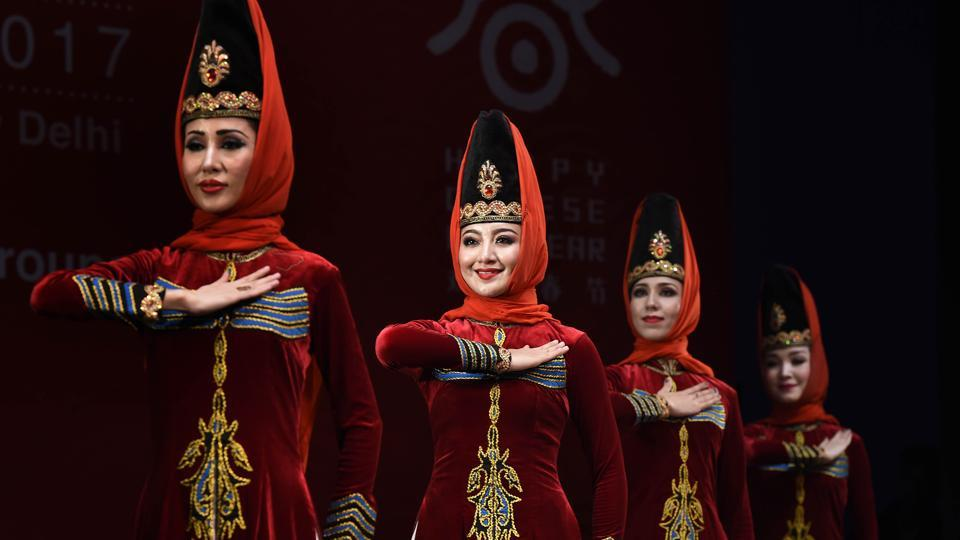 Members of Xinjiang Art Theatre song and Dance troupe perform in Chinese Cultural show group dance Jula. Regular visit of delegations, launching of China related books, organizing classes on Chinese language and culture are the activities successfully carried forward by ICEC to mention a few. (Arvind Yadav/HT PHOTO)
