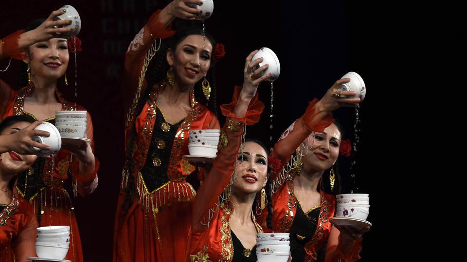 """Artists from Xinjiang Art Theatre song and Dance troupe perform 'Bowl Dance' during a cultural event celebrating Chinese New Year. The event was organized to celebrate """"Chinese New Year 2017"""" by Embassy of the People's Republic of China in the Republic of India, in association with China National Tourist Office and India China Economic and Cultural Council. (Arvind Yadav/HT PHOTo)"""